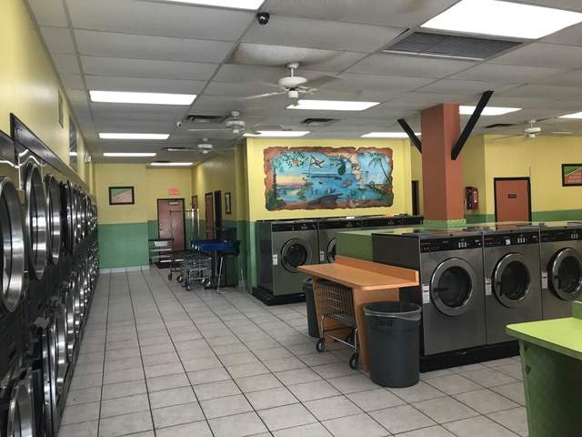 South U.S. 1. Row of washers and dryers. Counter space. Yellow and green interior.