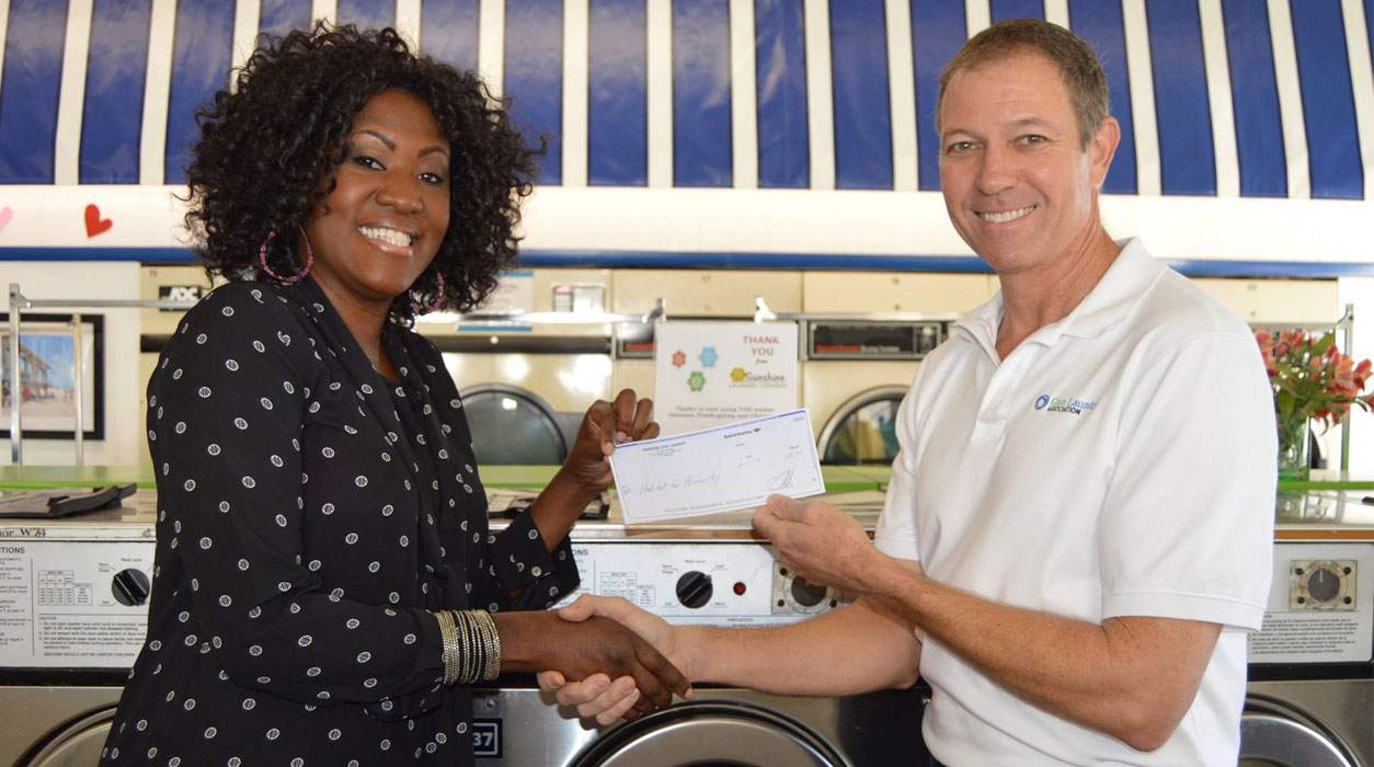 Tom Rhodes presenting a check to Habitat for Humanity